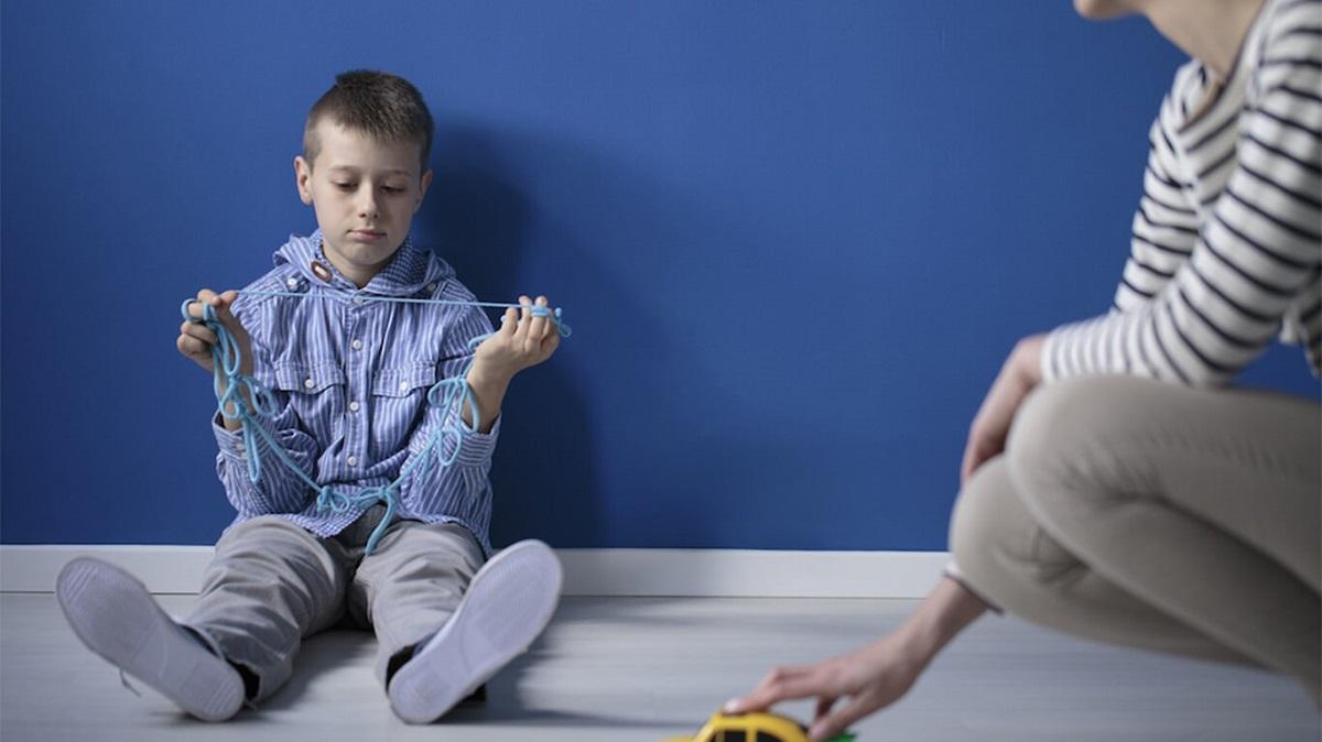احتلال اسپرگر و علائم و درمان آن