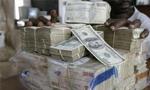 رئیس کل بانک مرکزی ایران سیاست جدید پولی کشور را که بر اساس آن ریال واحد پول بین المللی شده بود اعلام کرد(1352ش)