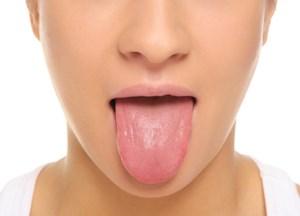 مزه خون زیر زبان به چه علت به وجود می آید؟